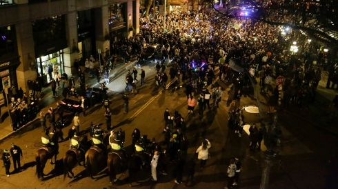 Police monitor Seattle Seahawks fans celebrating in the streets. Photograph: Jason Redmond/Reuters