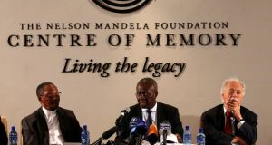 Deputy chief justice Dikgang Moseneke (centre)  is flanked by Professor Njabulo Ndebele (left) and George Bizos, Mr Mandela's lawyer, confidant and friend, at the Nelson Mandela Centre of Memory in Houghton, on Monday. Photograph: Siphiwe Sibeko/Reuters