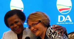 Anti-apartheid activist Mamphela Ramphele hugs opposition Democratic Alliance  leader Helen Zille at a news conference in Cape Town on January 28th to announce that Dr Ramphele would  run as presidential candidate for the DA in this year's South African election. The pact between the two lasted five days. Photograph: Mike Hutchings/Reuters