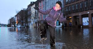 Commuter Michelle Lane pictured during severe flooding South Mall, Cork city this morning. Photograph: Daragh Mc Sweeney/Provision