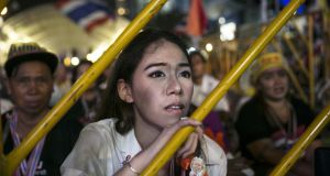 An anti-government protestor listens as leader Suthep Thaugsuban speaks about the elections during his daily speech in Bangkok,Thailand, on Monday. Photograph: Getty Images