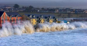High seas batter Tramore seafront in January. Prof John Sweeney of the Irish climate analysis and research unit at NUI Maynooth said the confluence of high winds, rising sea levels, low pressure and heavy rain, which has given rise to the flooding this week, is set to become more frequent.