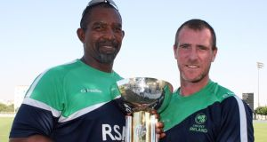 John Mooney pictured with Ireland coach Phil Simmons and the Intercontinental Cup trophy after his man of the match performance against Afghanistan in December's final in Dubai. Photograph:  Barry Chambers/Inpho
