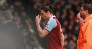 West Ham's Andy Carroll is sent off after a challenge with Swansea's Chico Flores last Saturday.