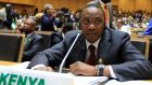 The African Union has urged Uhuru  Kenyatta to boycott his trial  — – something he has refused to do. Photograph: Tiksa Negeri(ETHIOPIA - Tags: POLITICS) /Reuters