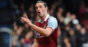 Andy Carroll of West Ham United reacts as he is sent off after a clash with Chico Flores of Swansea City last Saturday. Photo: Mike Hewitt/Getty Images