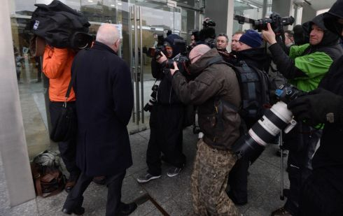 William McAteer, one of the three former Anglo Irish Bank executives, arriving at the court surrounded by photographers. Photograph: Dara Mac Dónaill/The Irish Times