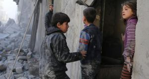 Children after what activists said was an air strike by forces loyal to Syria's president Bashar Al-Assad are pictured in Aleppo. Both sides of the conflict have been accused of committing human rights violations against children. Photograph: Ahmad Othman/Reuters
