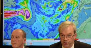 Brian Kenny of the Department of the Environment Community and Local Government and Seán Hogan, chairman of the National Emergency Co-ordination Group, briefing media on the adverse weather conditions. Photograph: Alan Betson/The Irish Times