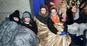 Before getting tickets on January 30. The first people in the queue- Charlene O'Neill from Knocklyon originally from Derry, Aoibhinn Loye from Armagh, Lauren Windsor from Portarlington, Co. Laois, Orla Carroll from Portarlington Co. Laois, Emma Kenny from Crumlin and Laura Carter from Tallaght - camp out for Garth Brooks tickets outside Stephen's Green Shopping Centre in Dublin Photo: Barbara Lindberg.