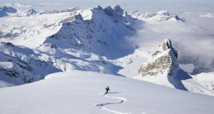 Off-piste skier in powder snow. Photograh: Getty Images