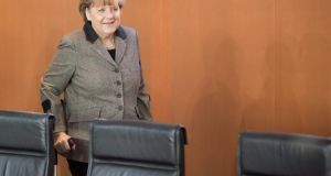 German Chancellor Angela Merkel, on crutches since a skiing accident at the end of December. Photograph: EPA/Joerg Carsten