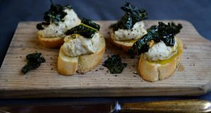 Crostini with white beans and roasted kale. Photograph: Cyril Byrne