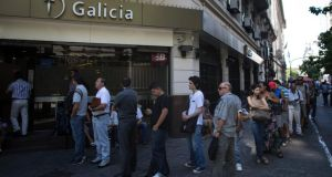 People are lined up outside Galicia bank to buy dollars in Buenos Aire