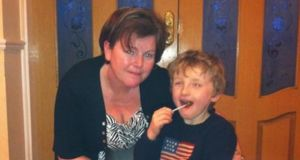 Helen Maher and her seven-year-old son Alex who has been waiting more than a year to get speech therapy.