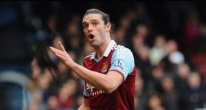 Andy Carroll of West Ham United reacts as he is sent off after a clash with Chico Flores of Swansea City during their Premier League match. Photograph: Getty Images