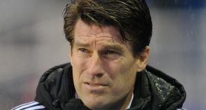 Michael Laudrup has strongly criticised the manner of his sacking by Swansea and has said he is taking legal advice over the dismissal.