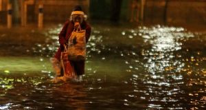 Awash: floodwaters in Cork city centre this week. Photograph: Niall Carson/PA Wire