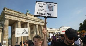 Among friends: Edward Snowden supporters in Berlin. Photograph: Sean Gallup/Getty