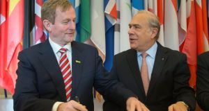 Taoiseach Enda Kenny with the head of the Organisation for Economic Co-operation and Development, Angel Gurria, in Paris yesterday. Photograph: Michel Euler/AP