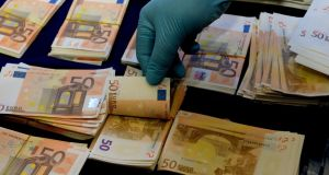 Some of the couterfeit €50  notes seized during a Garda operation targeting subversive activities. Photograph: David Sleator