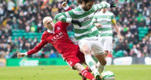 Aberdeen's Willo Flood tackles Celtic's Georgios Samaras  during the Scottish Cup fifth-round match at Celtic Park.  Photograph: Jeff Holmes/PA