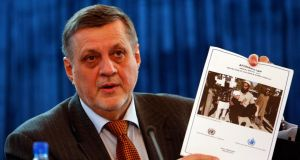 Jan Kubis, special representative of the secretary-general and head of the United Nations Assistance Mission in Afghanistan (UNAMA), shows a report during a news conference in Kabul today. Photograph: Mohammad Ismail/Reuters