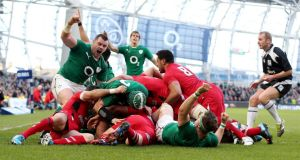Ireland's Cian Healy celebrates as Chris Henry scores a try against Wales in the Six Nations clash at the Aviva Stadium. Photograph:  Dan Sheridan/Inpho