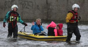 Residents are rescued by  boat  after  floods hit parts of  Limerick city last weekend. Photograph: PA