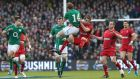 Andrew Trimble takes the high ball ahead of Wales' Liam Williams during the Six Nations match at the Aviva Stadium. Photograph:  Billy Stickland/Inpho