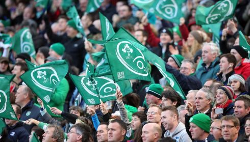 Irish flags raised high at the Aviva Stadium, for the Ireland vs Wales match today.  Photograph: Colm O'Neill/Inpho