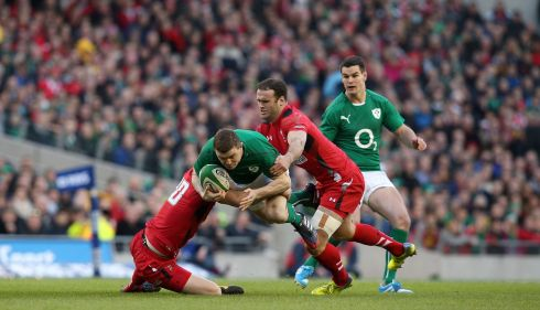Brian O'Driscoll is tackled heavily by Rhys Priestland and Jamie Roberts of Wales. Photograph: Colm O'Neill/Inpho
