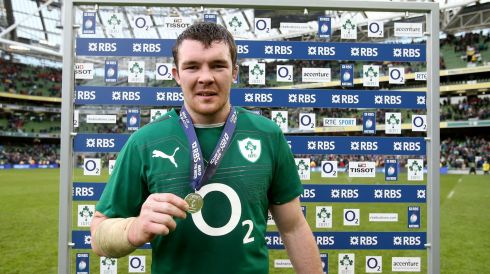 Peter O'Mahony recieves the RBS man of the match award from Margaret Frawley. Photograph: Dan Sheridan/Inpho