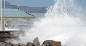 Waves crashing over the bandstand in Dun Laoghaire earlier this week. High tides and strong winds continued to batter Irish coasts today. Photograph: Eric Luke / The Irish Times