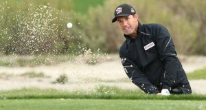 Pádraig Harrington of Ireland chips from the bunker onto the 11th green during the third round of the AT&T Pebble Beach National Pro-Am at the Monterey Peninsula Country Club. Photograph:  Christian Petersen/Getty Images