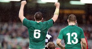 Ireland's Peter O'Mahony celebrates alongside Brian O'Driscoll at the Aviva  Stadium. Photograph: Colm O'Neill/Inpho