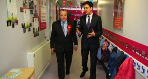 Labour leader Ed Miliband with candidate Michael Kane on the Wythenshawe and Sale East byelection campaign trail. Photograph: Gareth Fuller/PA