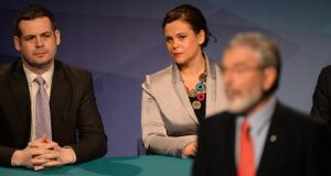 Pearse Doherty and Mary Lou McDonald, look on as Gerry Adams delivers his keynote speech at the Sinn Féin ardfheis in Wexford. Photograph; Dara Mac Dónaill