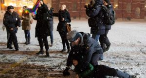 An Interior Ministry member detains a gay rights activist attempting to hold a protest rally in Red Square near the Kremlin in central Moscow on Friday, shortly before Vladimir Putin opened the Sochi Winter Olympics. Photograph: Yevgeny Feldman/Russia