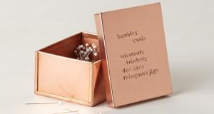 TRENDING . . . LOVE IN A BOX Anthropologie's (0044-800 0026 8476, anthropologie.eu) new Notes of Affection collection is a series of copper-plated metal desk top boxes and receptacles for the tidy minded that word plays on that most beautiful of things, copperplate handwriting. The collection includes a sweet paper clip box that could also double as a jewellery box, £10 (€12), a magazine holder, €28 (€33.50) and a tray holder, £22 (€26.50). If you want to commit words to a loved one pay The Pen Corner (01-6793641) on Dublin's College Green a visit and invest in an old-fashioned writing instrument and some fine gauge paper on which to pen an old-fashioned letter. What could be more romantic?