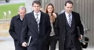 Businessman Seán Quinn, accompanied by his son Seán Quinn jnr, solicitor Niall McPartland and daughter Brenda Quinn, arriving at the Dublin Circuit Criminal Court yesterday, where he gave evidence in the trial of former Anglo Irish Bank directors Seán FitzPatrick, William McAteer and Pat Whelan. Photograph: Eric Luke