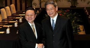 Wang Yu-chi, left, Minister of Taiwan's Mainland Affair Council, shakes hands with Zhang Zhijun, right, Minister of China's Taiwan Affairs Office, before their meeting in Nanjing in east China's Jiangsu province. It's the first official contact between the two governments since the civil war in 1940s. Photograph: EPA