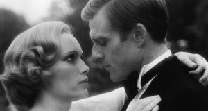 Mia Farrow, as Daisy Buchanan, and Robert Redford, as Jay Gatsby,  in a scene from The Great Gatsby, based on the novel by F. Scott Fitzgerald, published in 1925 but did not assume classic status till the 1940s.