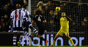 Victor Anichebe heads his side's equaliaser  past Petr Cech at The Hawthorns.  Photograph: aurence Griffiths/Getty Images