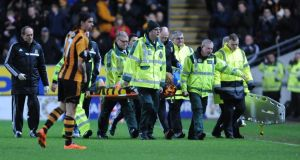 Hull City's Paul McShane is stretchered off injured during the Barclays Premier League match at the KC Stadium. Photograph:   Anna Gowthorpe/PA Wire.