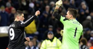 Chelsea's Fernando Torres (left) and West Bromwich Albion goalkeeper Ben Foster have a dispute after the final whistle.  Photograph:  Martin Rickett/PA Wire.