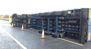 A truck overturned on M8 at Fermoy overpass. The driver was taken to hospital with a minor injury. Photograph courtesy of An Garda Síochána.