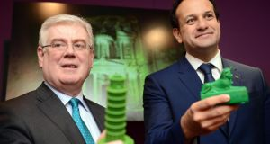 Tánaiste Eamon Gilmore and Minister for Tourism Leo Varadkar at the launch of Tourism Ireland Global Greening 2014 in Dublin.  The initiative sees global  landmarks turn green for St Patrick's Day. Photograph: Eric Luke