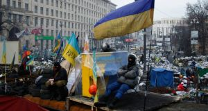Anti-government protesters rest at the barricades in Kiev this week. Rallies on Kiev's Independence Square, or Maidan, have attracted people from many countries, including Russia. Photograph: David Mdzinarishvili/Reuters