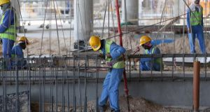 Migrant labourers working in Qatar in preparation for the 2022 World Cup. Photograph: Karim Jaafar/Getty Images